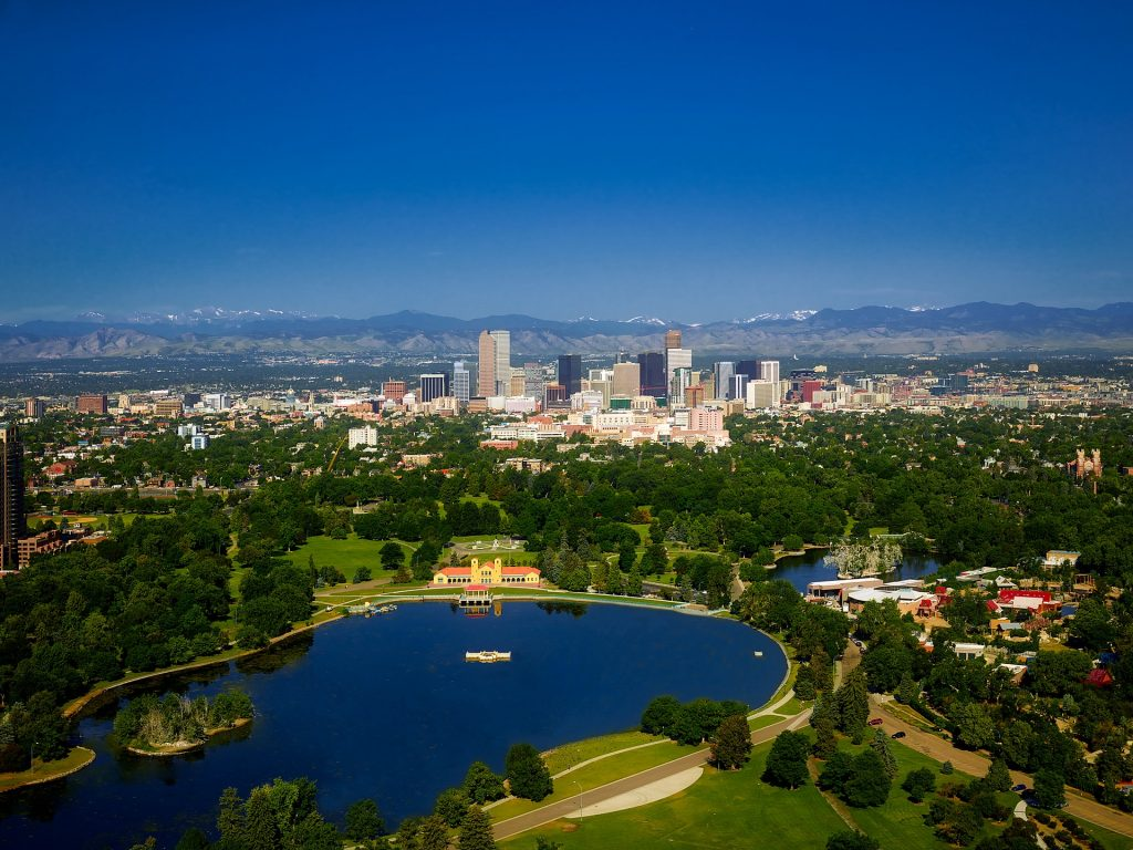 photo depicting Denver downtown with panoramic view of the Rocky Mountains